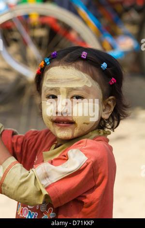 Little girl with Thanaka makeup in Nyaung oo Market in Bagan, Myanmar 2 - Stock Photo