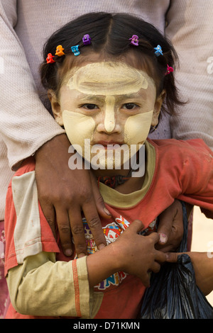 Little girl with Thanaka makeup in Nyaung oo Market in Bagan, Myanmar - Stock Photo