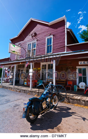 Harley davidson motorcycle in front of the liston corfu for Old fashioned general store near me