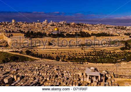Gravestones, Jewish Cemetery on the Mount of Olives, with the Dome of the Rock on the Temple Mount in background, - Stock Photo
