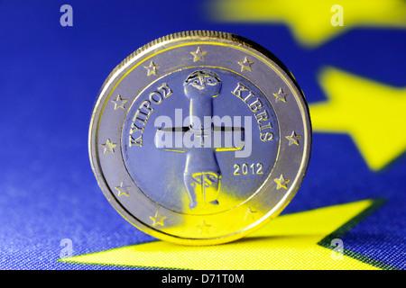 Euro-coin one of Cyprus on EU flag, Cyprus crisis - Stock Photo