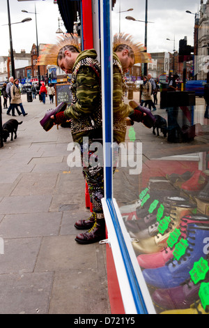 Punk outside boot shop in Camden Town. - Stock Photo