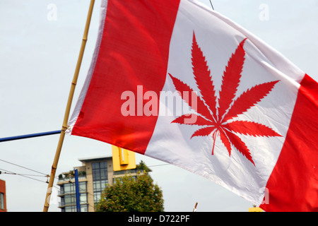 Canadian flag with Marajuana leaf print, Pro legalisation of Cannabis and Marijuana marching at Gay Pride, Vancouver - Stock Photo
