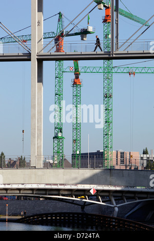 Berlin, Germany, pedestrians on the Marie-Elisabeth-Lueders-bar, behind Construction cranes - Stock Photo