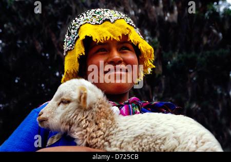 Girl in native dress holding lamb .Pisac.Peru. - Stock Photo