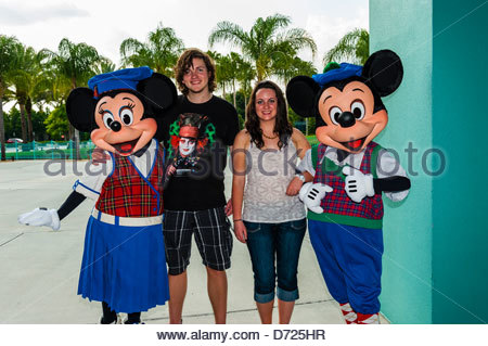 Mickey Mouse and Minnie Mouse with teenagers, Fantasia Gardens miniature golf course, Walt Disney World, Orlando, - Stock Photo