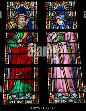 Stained glass window depicting Saint Peter and Saint Gulielmus in the church of Our Lady in Saint Truiden, Belgium. - Stock Photo
