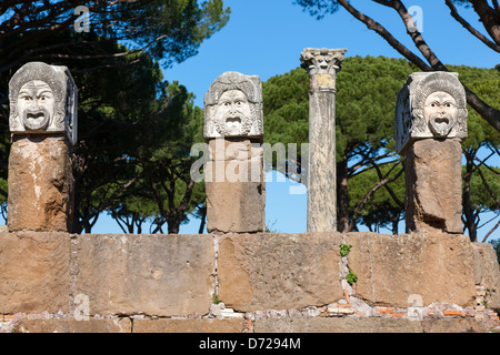 Carved Roman heads in Ostia Antica, Rome, Italy - Stock Photo
