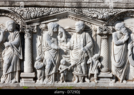 Carved Roman sarcophagus in Ostia Antica - Stock Photo