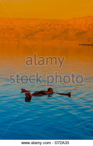 Tourists enjoying the waters of the Dead Sea (with Jordan in the background) at the Leonardo Plaza Dead Sea Hotel, - Stock Photo