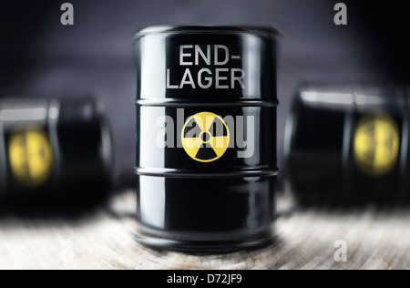 Nuclear waste barrel with the label Final disposal site - Stock Photo