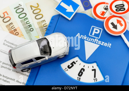 Miniature car, ticket and parking disc, higher punishments for Falschparker - Stock Photo