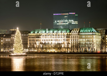Christmas fir on the Inner Alster and hotel Four seasons in Hamburg, Germany, Europe - Stock Photo