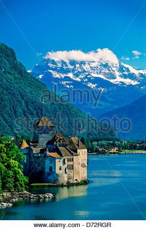 Castle of Chillon (Dent du Midi in background), Lac Leman (Lake Geneva), Montreux, Switzerland - Stock Photo