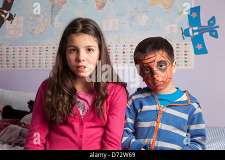 Siblings in their room - Stock Photo
