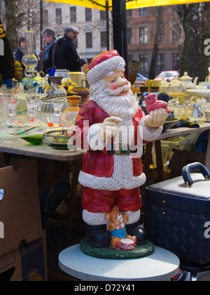 Large Father Christmas figurine dominating a stall in a flea market in Grunerlokka Oslo Norway - Stock Photo