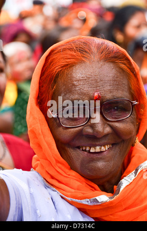 Muslim lady smiling on the way of event - Stock Photo