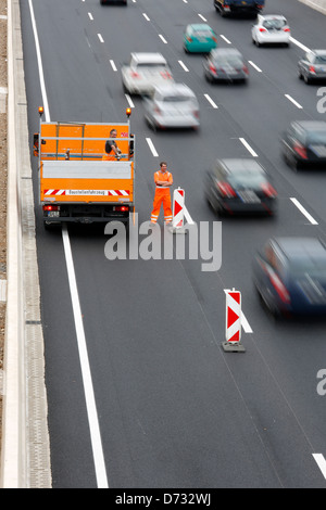Koeln, Germany, Cologne 'ring road, an employee of the road reduces a highway construction site - Stock Photo