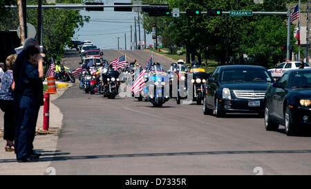 April 27, 2013 - West, Texas, U.S -  Bystanders salute the passing funeral procession for Buck Uptmor, 45, a victim - Stock Photo