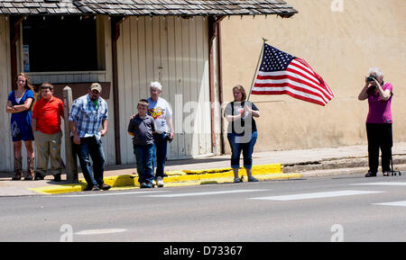 April 27, 2013 - West, Texas, U.S -  People watch the funeral procession through town for Buck Uptmor, 45, a victim - Stock Photo