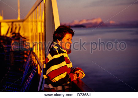 Late evening on board M/S Nordlys (coastal steamer) during Midnight Sun, near Bodo, Arctic, Northern Norway - Stock Photo
