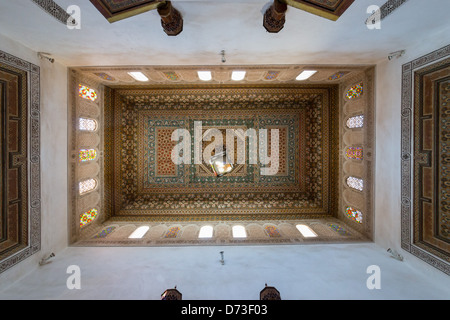 Marrakesh - the Bahia Palace. Painted cedarwood coffered and beamed ceiling. - Stock Photo