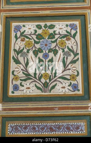Marrakesh - the Bahia Palace. Detail of painted wooden pillar. - Stock Photo