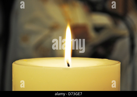 Wedding candle at a Greek orthodox wedding ceremony - Stock Photo