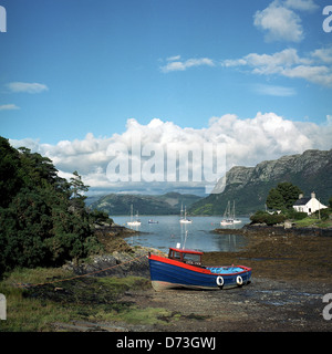 Plockton, United Kingdom, a fishing boat lying on the seabed - Stock Photo