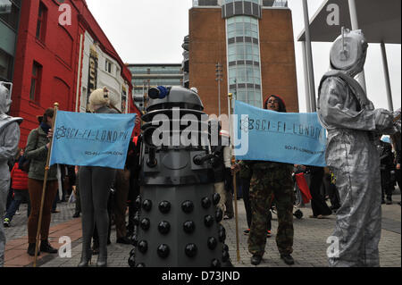 Stratford, London, UK. 28th April 2013. A Dalek and Cybermen at front of the costume parade. The Sci-Fi-London Costume - Stock Photo