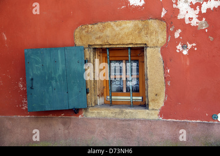 Small window with an open shutter - Stock Photo