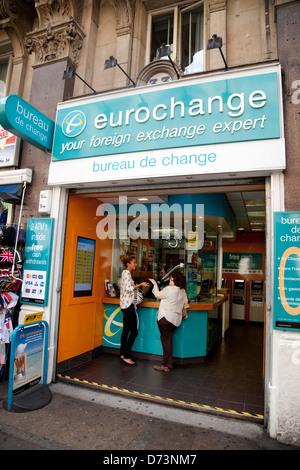 People at a money exchange bureau de change shop for foreign stock photo royalty free image - Bureau de change charles de gaulle ...