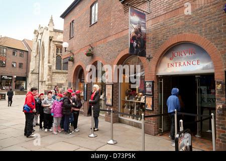 School children on a school trip waiting to enter the Jorvik Viking Centre, York, yorkshire, UK - Stock Photo