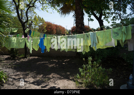 Rags used to clean cars at a high school fund raising car wash dry on a clothesline. - Stock Photo
