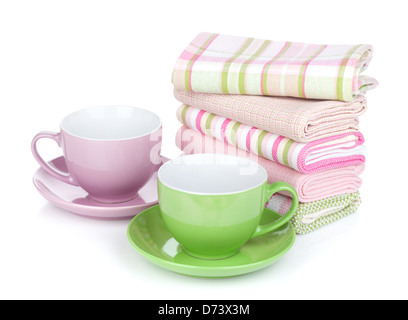 Two coffee cups and kitchen towels. Isolated on white background - Stock Photo