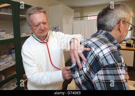 Bad Segeberg, Germany, Uwe thinker examines a patient in his practice without limits - Stock Photo