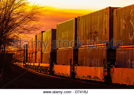 A freight train carrying contrainers, near Gallup, New Mexico USA. - Stock Photo