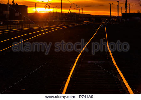 Train tracks at sunset, Gallup, New Mexico USA. - Stock Photo