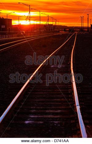 Train tracks at sunset, Gallup, New Mexico USA. - Stock Photo