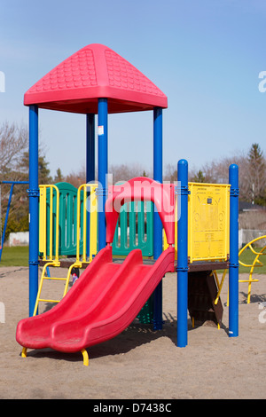 Children's Playground Slides, Outdoors School Grounds - Stock Photo