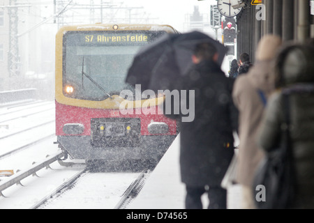Berlin, Germany, S-train and Passengers with snow on the Charlottenburg S-Bahn station - Stock Photo