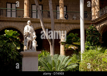 marble statue of Christopher Columbus in the courtyard of the city museum Palacio de los Capitanes Generales in - Stock Photo