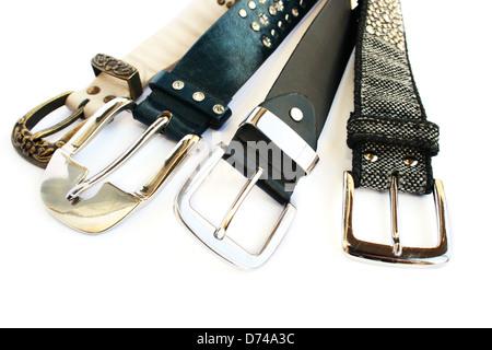 Fashionable belts isolated on white background. - Stock Photo
