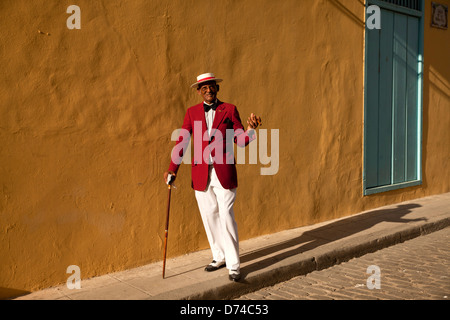 the actor Pedro Pablo Perez with red suit, hat and cigar in Havana, Cuba, Caribbean - Stock Photo