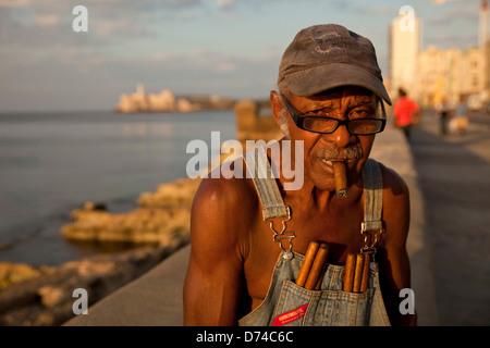 elderly man with cigar at the malecon in Havana, Cuba, Caribbean - Stock Photo