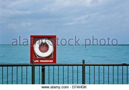 Life preserver inside a case on a railing, Aqua Lake, Chicago, Cook County, Illinois, USA - Stock Photo