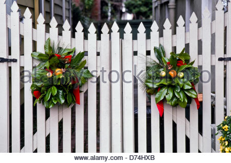 christmas decorations of greenery wreaths decorate on white picket fence gate portsmouth virginia - Christmas Fence Decorations