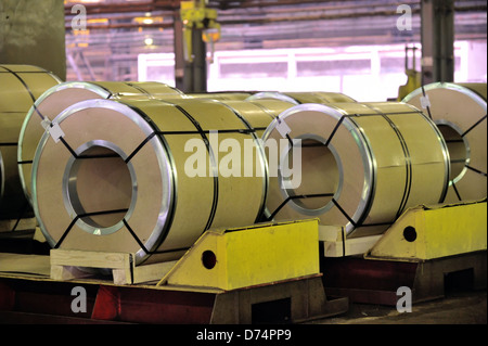rolls of steel sheet in factory - Stock Photo