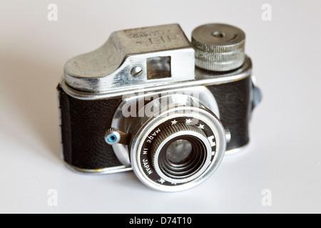 Real working analoque mini film camera - Stock Photo