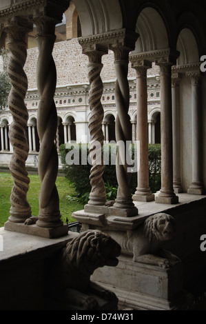 Archbasilica of Saint John Lateran. Detail of the cloister, in cosmatesque style work by Vassalletto family. Rome. - Stock Photo